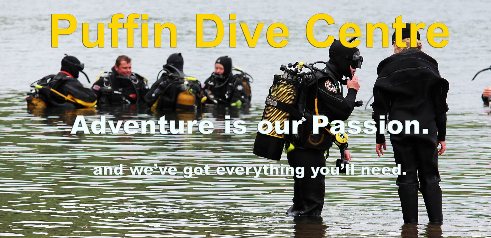Puffin Dive Centre. Adventure is our passion diving tanks in background